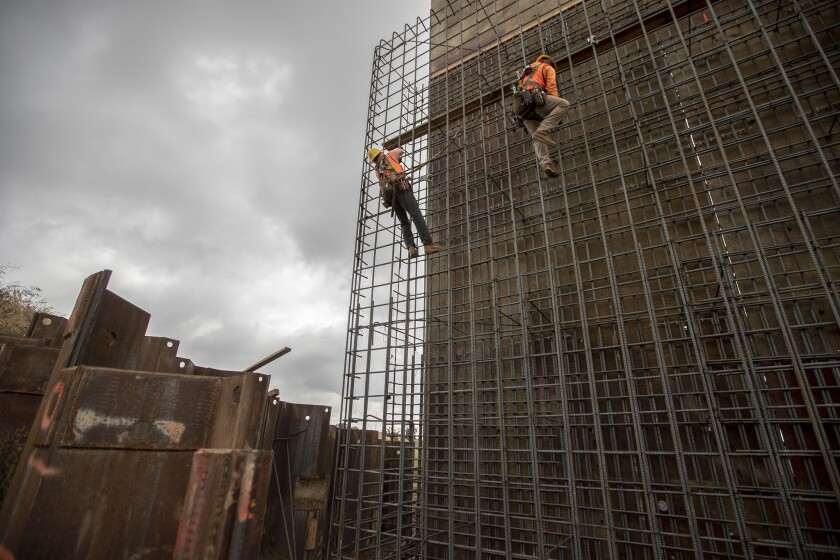 Workers tie rebar on a support structure located on the South end of the Cedar Viaduct section of the California High Speed Rail Project in Fresno.