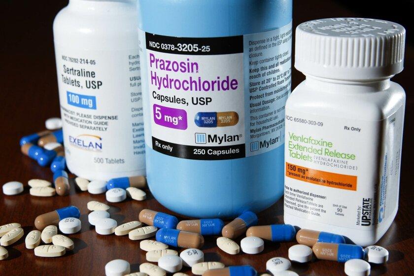 Three prescription drugs used for treating PTSD.