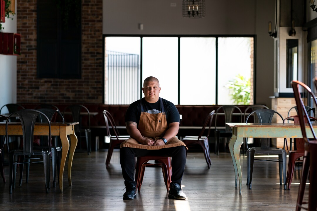 Brad Wise, executive chef and partner in Trust Restaurant Group, is seated in his Cardellino restaurant in Mission Hills, which will be reopening in the coming weeks.