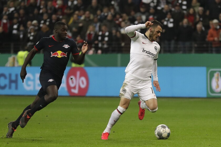 Frankfurt's Filip Kostic, right, is challenged by Leipzig's Dayot Upamecano during the German DFB Cup third round match between Eintracht Frankfurt and RB Leipzig at the Commerzbank-Arena stadium in Frankfurt, Germany, Tuesday, Feb. 4, 2020. (AP Photo/Michael Probst)