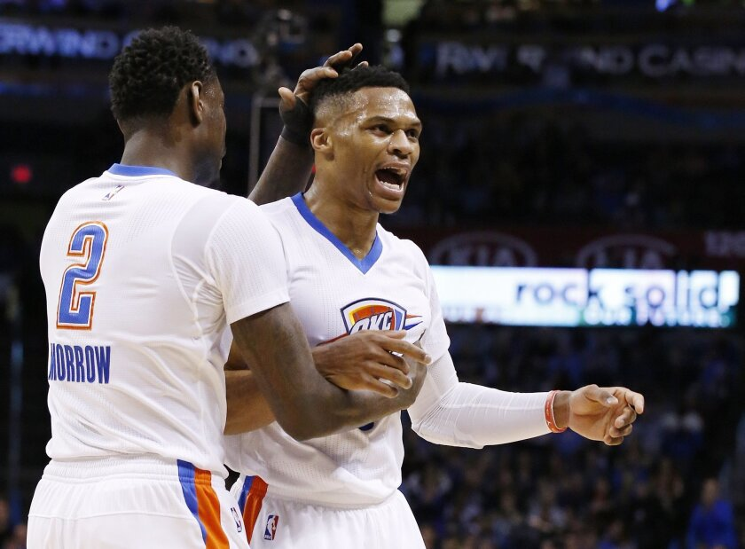 Oklahoma City Thunder guard Russell Westbrook, right, celebrates with teammate Anthony Morrow (2) in the second quarter of an NBA basketball game against the New Orleans Pelicans in Oklahoma City, Thursday, Feb. 11, 2016. (AP Photo/Sue Ogrocki)