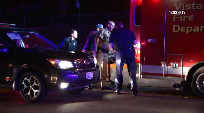 Vista firefighters and paramedics and California Highway Patrol officers load an injured pedestrian into an ambulance Tuesday night on eastbound state Route 78. The man died Tuesday night, and was identified Friday as Matthew Keegan, 36.