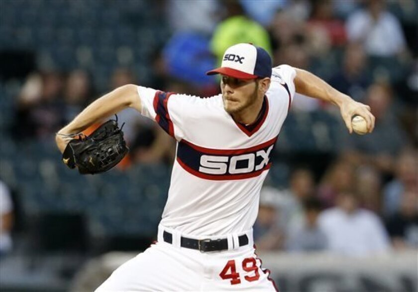 Chicago White Sox starting pitcher Chris Sale delivers during the first inning of a baseball game against the Houston Astros, Wednesday, Aug. 28, 2013, in Chicago. (AP Photo/Charles Rex Arbogast)