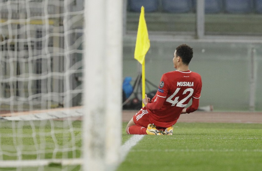 Bayern's Jamal Musiala celebrates after scoring his side's second goal during the Champions League round of 16 first leg soccer match between Lazio and Bayern Munich at the Olympic stadium in Rome, Tuesday, Feb. 23, 2021. (AP Photo/Gregorio Borgia)