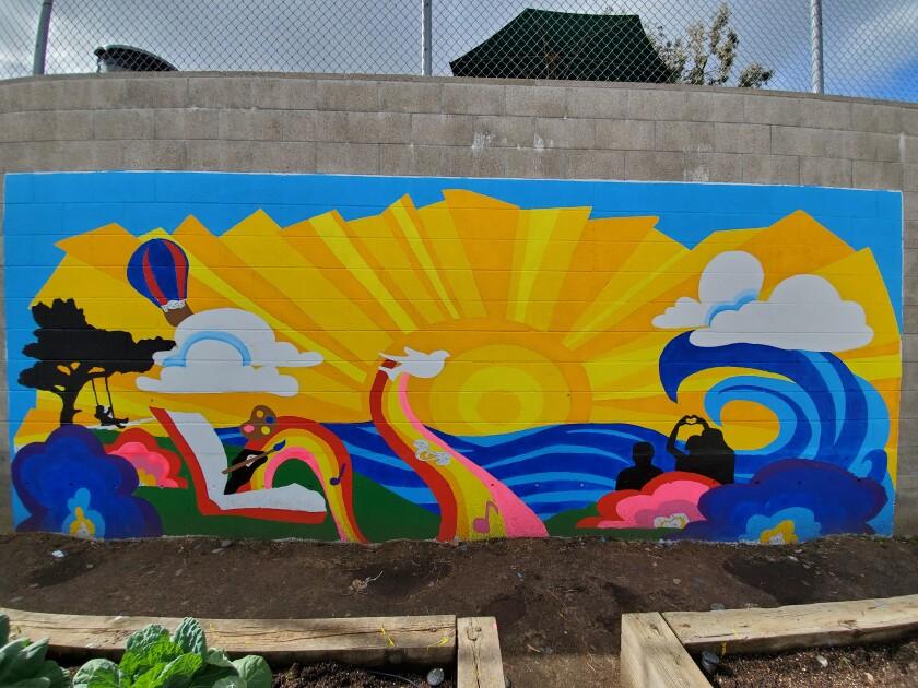 The new mural in R. Roger Rowe School's garden.