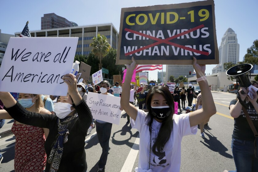 Protestors march at a rally against Asian hate crimes past the Los Angeles Federal Building, March 27, 2021.