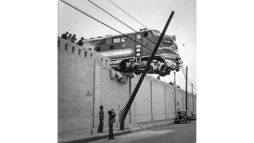 Jan. 25, 1948: A Santa Fe Diesel passenger locomotive hangs over Aliso St. after running off the end
