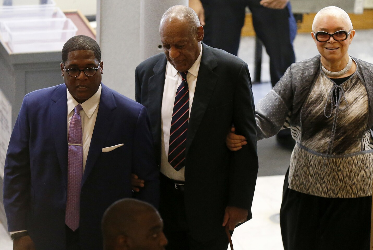 Bill Cosby, center, and wife Camille enter the Montgomery County Courthouse in Norristown, Pa., on Monday.