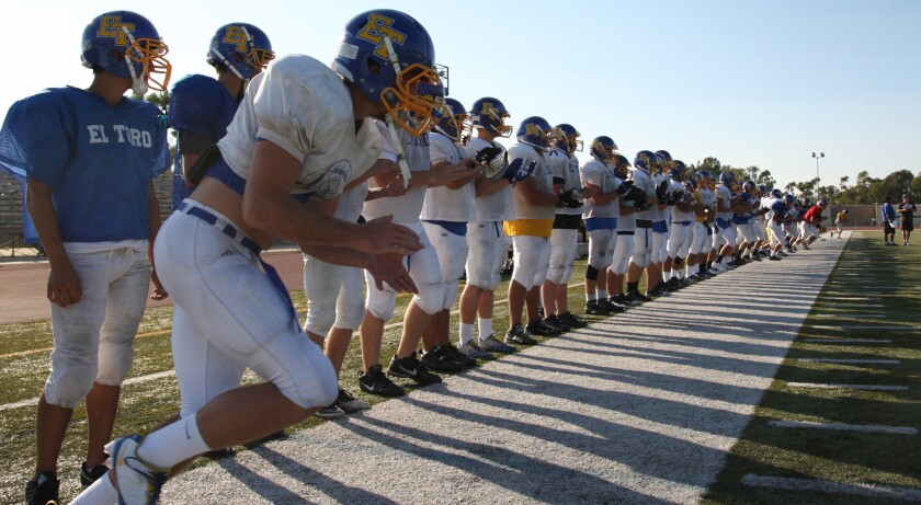 El Toro football players take part in a practice session in September 2012. A new state law prohibits public middle and high schools from holding full-contact football practices that exceed 90 minutes a day.