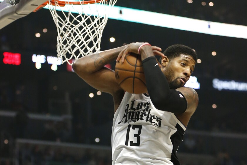 Clippers forward Paul George grabs a rebound.