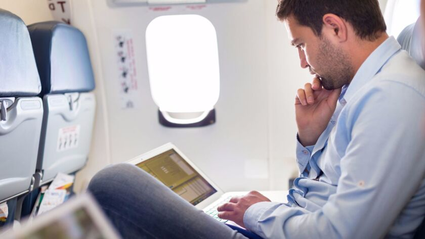 Businessman working with laptop on airplane. ** OUTS - ELSENT, FPG, CM - OUTS * NM, PH, VA if source