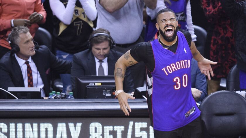 Rapper Drake reacts courtside as the Toronto Raptors play the Golden State Warriors during the first