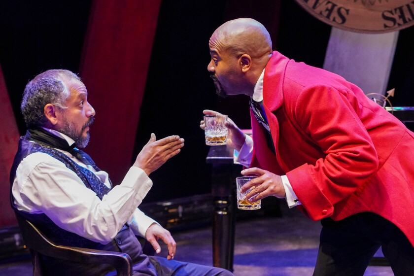 """Jesse Perez, left, and Larry Bates in San Diego Repertory Theatre's """"JQA."""""""