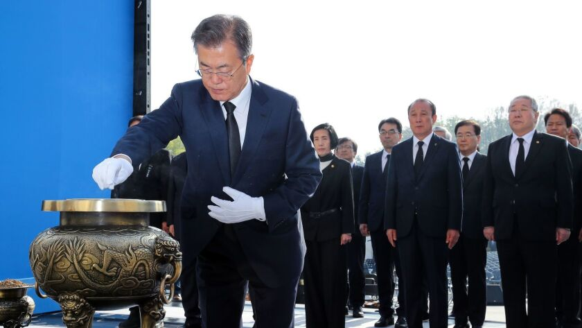 South Korean President Moon Jae-in burns incense at a national cemetery in northern Seoul to mark the anniversary of the April 19 Revolution, a popular pro-democracy and anti-dictatorship uprising in 1960.
