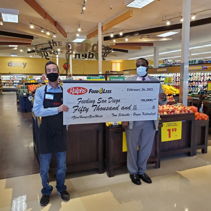Maron Dean, store leader at the Encinitas Ralphs, presented the $50,000 check to Feeding San Diego.