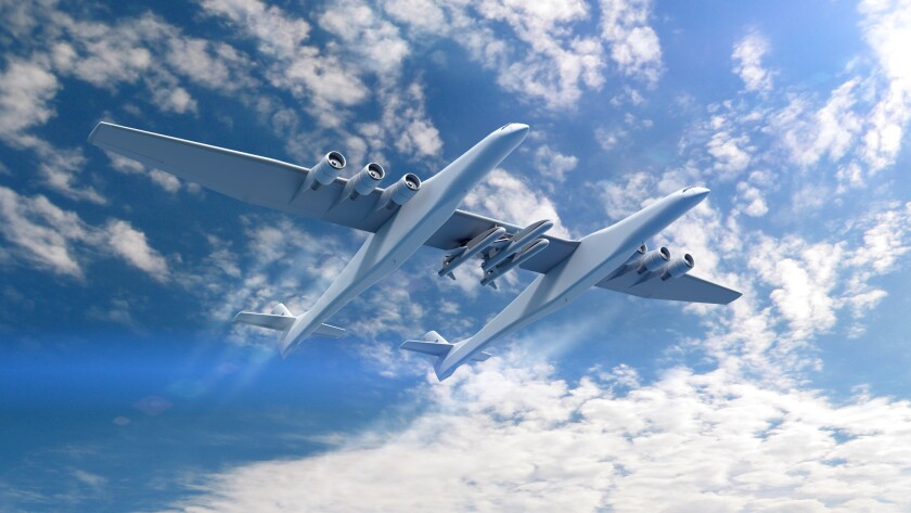 A conceptual rendering of the Stratolaunch aircraft and the Orbital ATK Pegasus XL rockets.