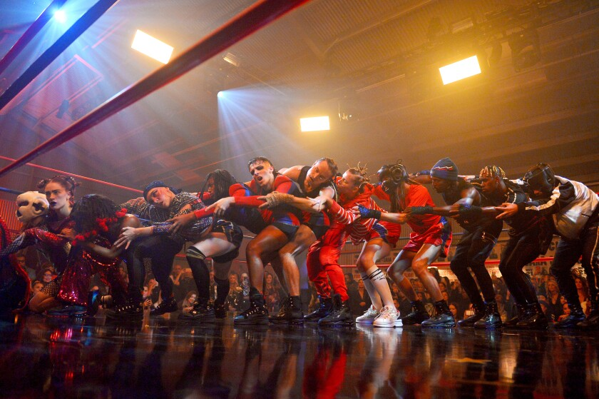 Dancers perform onstage during Puma X Balmain collaboration event at Milk Studios
