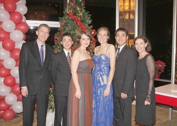 The season erupted in song on Dec. 19 when the Los Angeles Children's Chorus' elite Chamber Singers performed a Holiday Salon Concert. The chorus' board Chairman, David Scheidemantle, left, and Artistic Director Anne Tomlinson flank alumni who returned to perform with the Chamber Singers: from second left, Albert Wonjae Pae, Ariadne Greif, Adrienne Pardee and Andrew Wonjun Pae.
