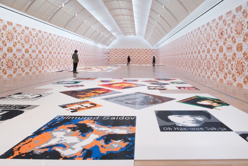 """People look at Lego portraits of political activists and free speech advocates in """"Ai Weiwei: Trace"""""""