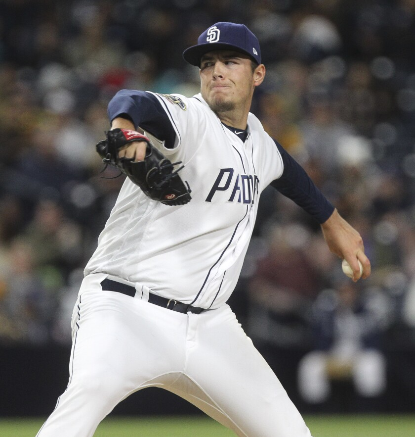 Padres' Brad Wieck pitches to the Rockies in the eighth inning at Petco Park on April 16, 2019.
