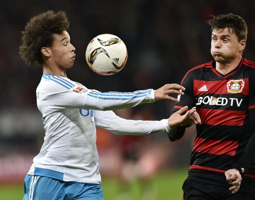 FILE - In this Sunday, Nov. 29, 2015 file photo, Schalke's Leroy Sane, left, and Leverkusen's Sebastian Boenisch, right, challenge for the ball during the German Bundesliga soccer match between Bayer 04 Leverkusen and FC Schalke 04 in Leverkusen, Germany. Many nations are betting on youth at the Eu