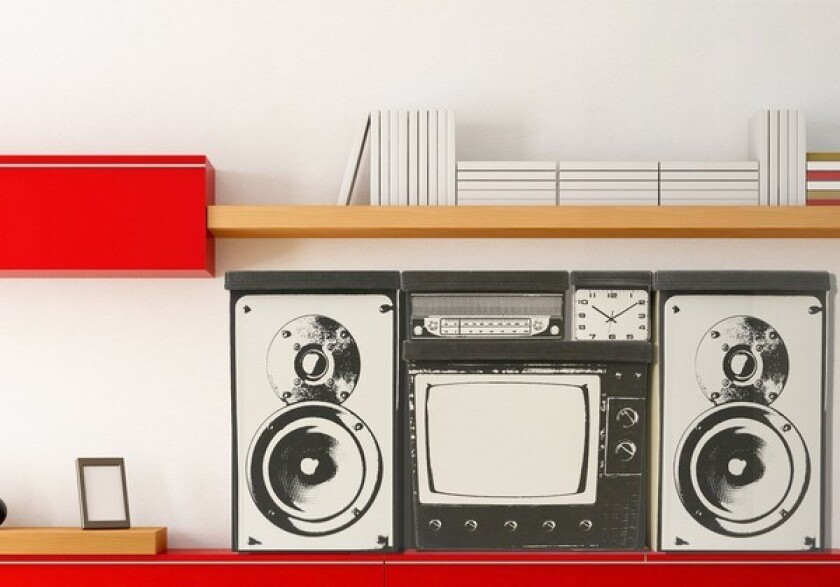 The Monrovia-based design firm MollaSpace has started selling its Home Storage System, canvas storage bins printed with images of a retro clock, radio, TV and stereo speaker.