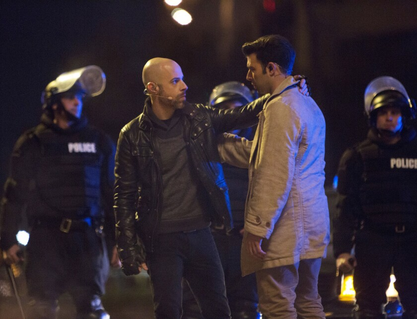 Chris Daughtry, left, will play Judas and Jencarlos Canela will portray Jesus in the two-hour musical airing from New Orleans.