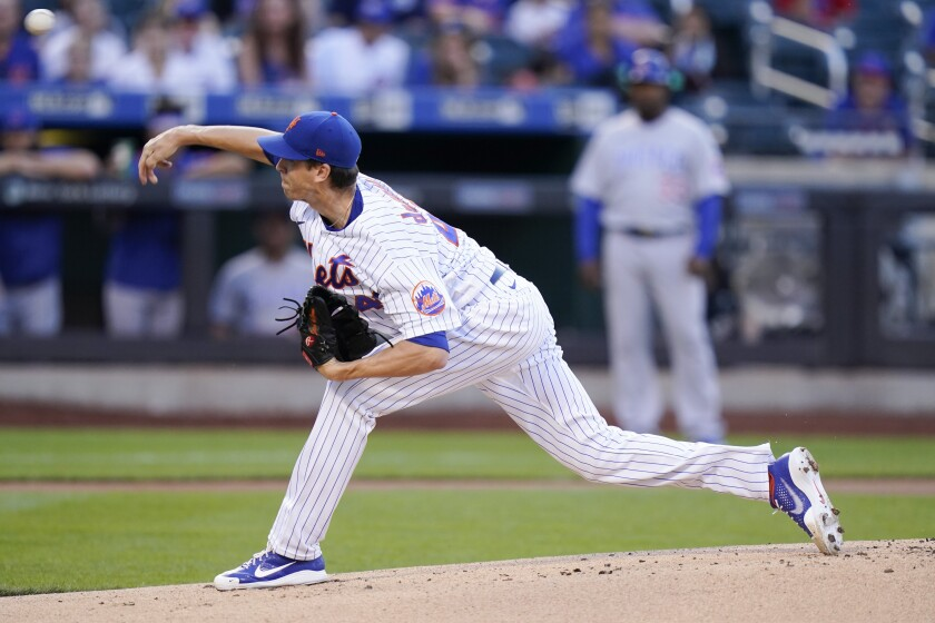 New York Mets' Jacob deGrom delivers a pitch during the first inning of a baseball game against the Chicago Cubs Wednesday, June 16, 2021, in New York. (AP Photo/Frank Franklin II)