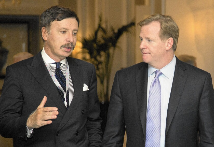 Stan Kroenke, left, owner of the St. Louis Rams, talks with NFL Commissioner Roger Goodell during a break in the 2013 NFL fall meeting in Washington.
