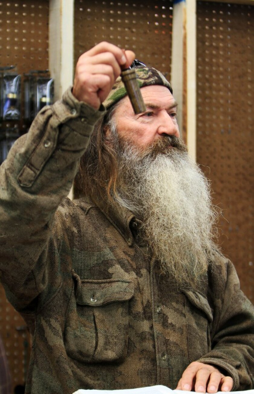 """Phil Robertson of the A&E reality show """"Duck Dynasty"""" shows the 1 millionth duck call assembled at his warehouse. Robertson was suspended indefinitely by A&D after making controversial remarks about gay people and black people."""