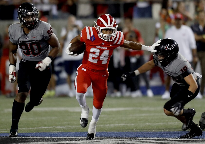 Mater Dei's Quincy Craig runs for a touchdown against Corona Centennial on Aug. 23, 2019.