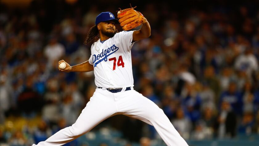 Dodgers relief pitcher Kenley Jansen pitches against the San Francisco Giants.