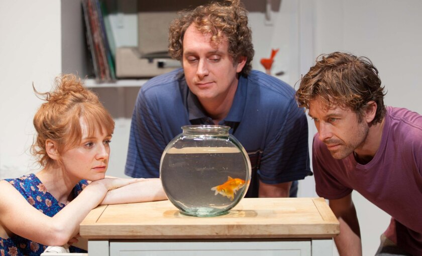 """In Rogue Machine's """"Need to Know,"""" Lilly (Corryn Cummins) and Steven (Lucas Near-Verbrugghe, right) feel like fish in a bowl, watched by their neighbor (Tim Cummings)."""