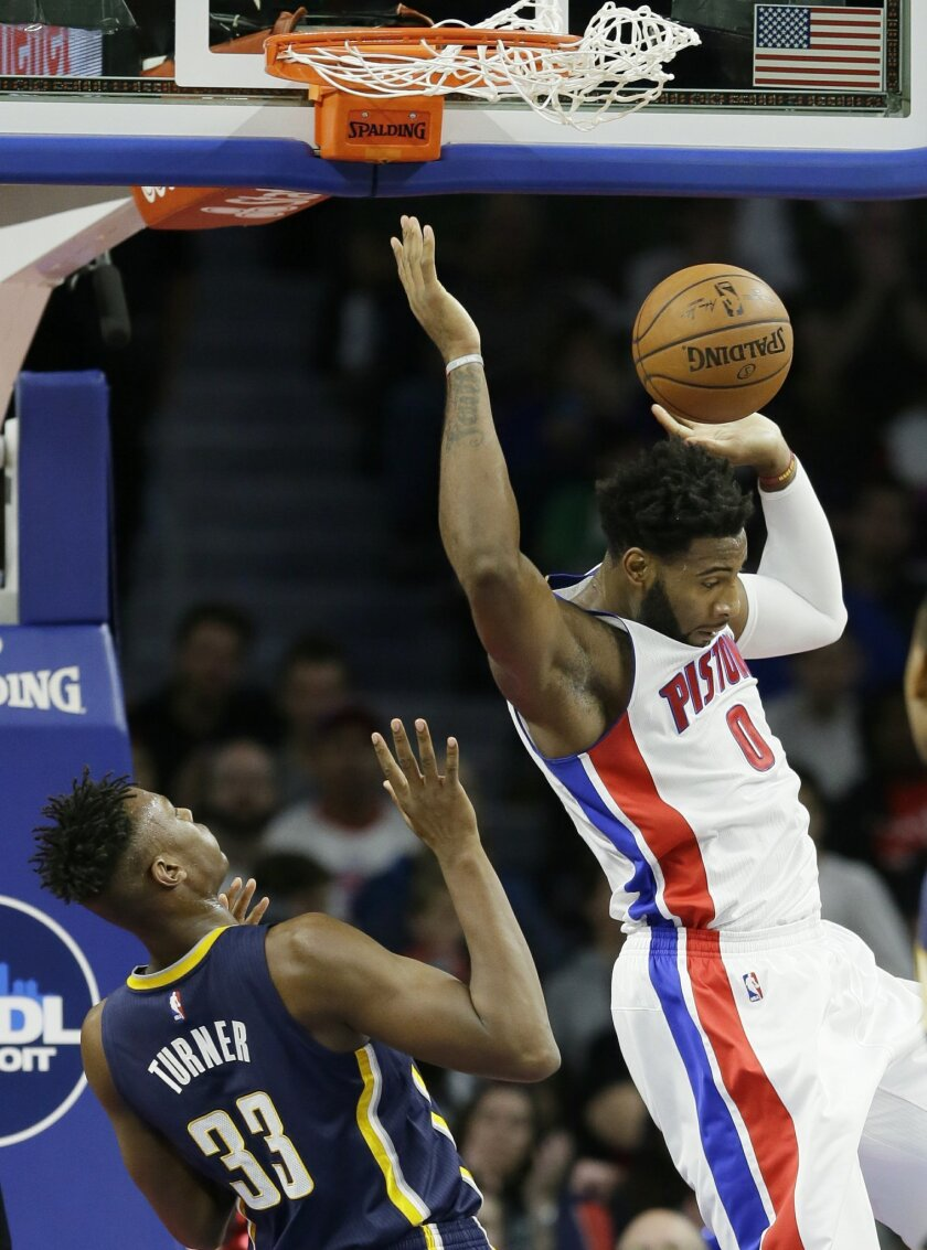 Detroit Pistons center Andre Drummond (0) dunks against Indiana Pacers forward Myles Turner (33) during the first half of an NBA basketball game, Tuesday, Nov. 3, 2015, in Auburn Hills, Mich., (AP Photo/Carlos Osorio)
