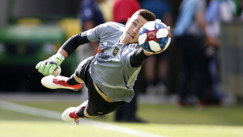 LAFC goalkeeper Pablo Sisniega makes a save during a warm up exercise ahead of a game against the Seattle Sounders in April 2019.