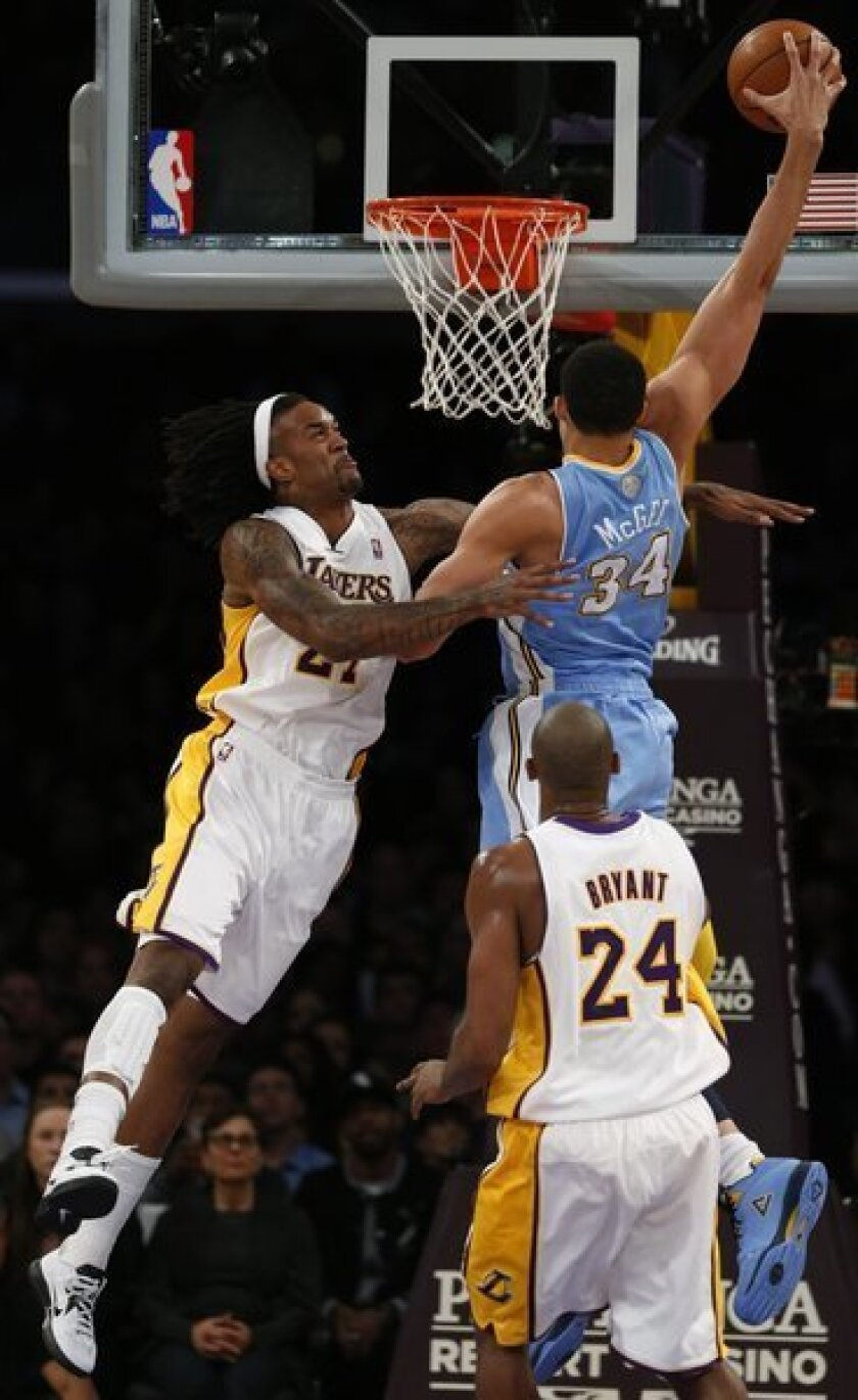 Nuggets center JaVale McGee misses a dunk attempt over Jordan Hill in the first half of game Jan. 6, during which Hill was injured.