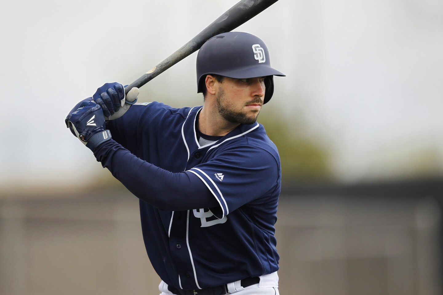 San Diego Padres Austin Hedges bats during a spring training practice in Peoria on Feb. 19, 2018. (Photo by K.C. Alfred/ San Diego Union -Tribune)