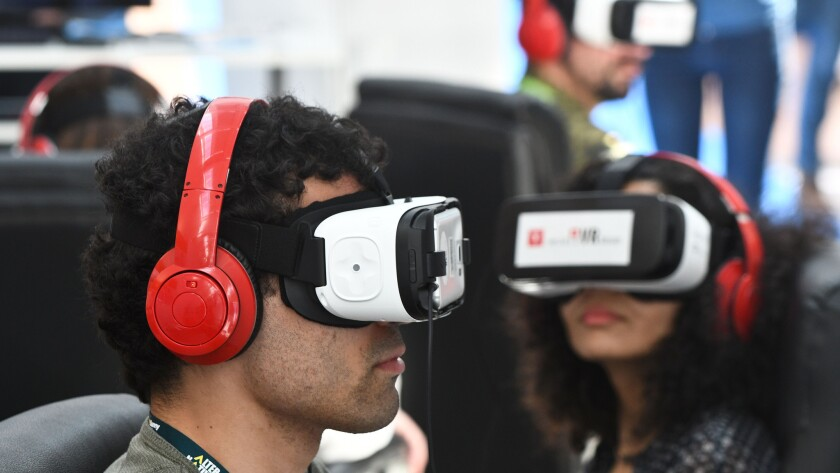 People test out Samsung's Gear VR powered by Oculus during Sunny Side of the Doc, an international market for documentary films, in La Rochelle, France, on June 21, 2016.