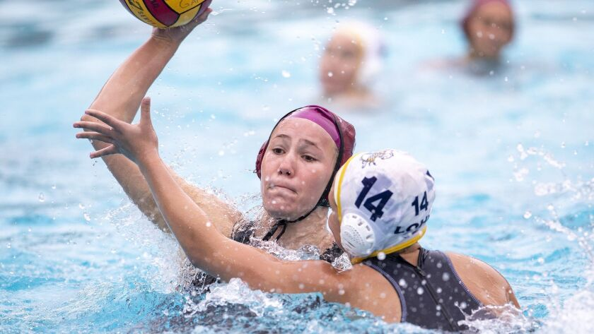 Laguna Beach's Nicole Struss takes a shot under pressure from Los Osos' Brooklyn Young during a nonl