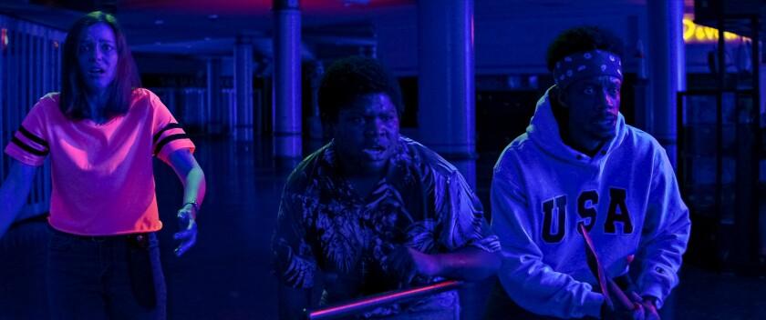 "A frightened Gillian Jacobs, Benjamin Flores Jr. and Darrell Britt-Gibson in ""Fear Street: 1666."""