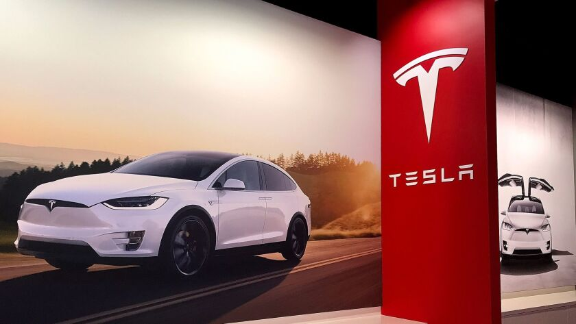 Posters of the Tesla Model X at a Tesla showroom in Corte Madera, Calif., on Aug. 29. The National Labor Relations Board has ordered the automaker to respond to worker complaints.