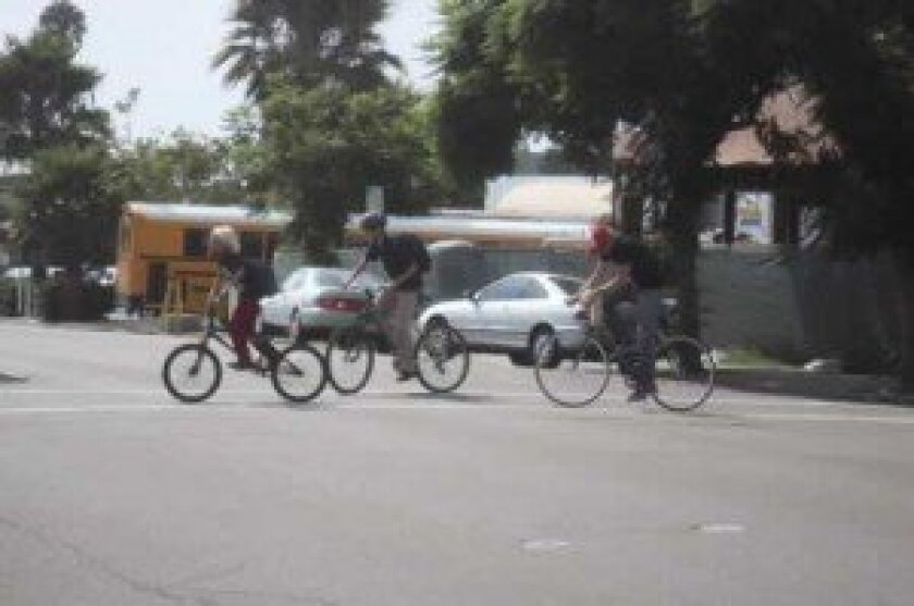 Biking-in-the-Village-group-300x199