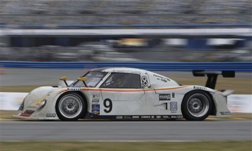 Joao Barbosa, of Portugal, drives the Action Express Racing Porsche Riley during the final hours of the Rolex 24 hour auto race at the Daytona International Speedway in Daytona Beach, Fla., Sunday, Jan. 31, 2010. (AP Photo/John Raoux)