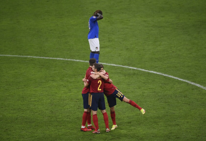 Spain players celebrate at the end of the UEFA Nations League semifinal soccer match between Italy and Spain at the San Siro stadium, in Milan, Italy, Wednesday, Oct. 6, 2021. Spain won the match 1-2. (Marco Bertorello/Pool via AP)
