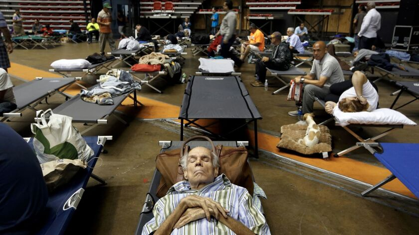 Hundreds of people take shelter at the Roberto Clemente Coliseum in San Juan, Puerto Rico.