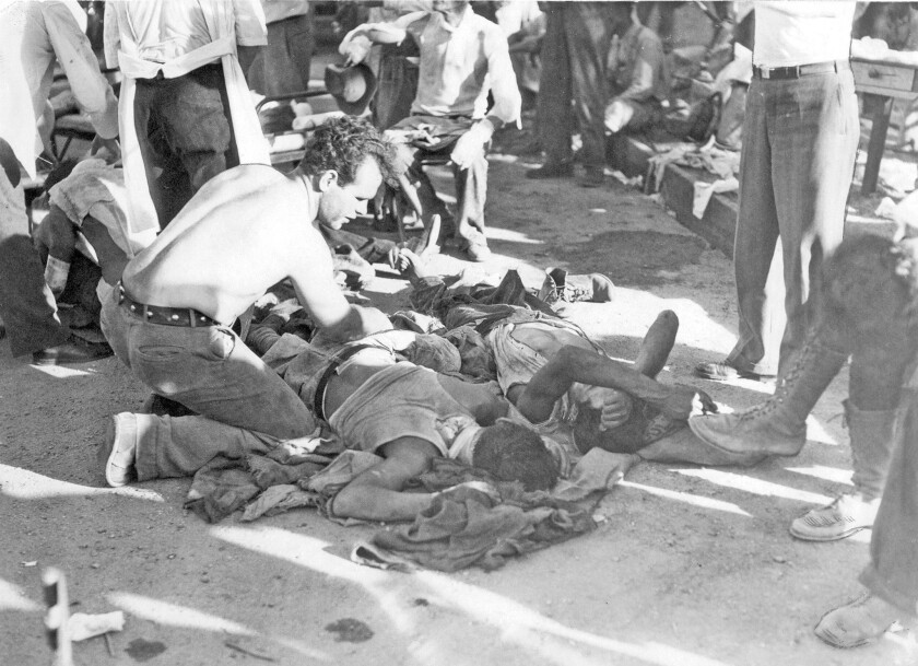 Men injured in the Griffith Park fire of 1933 receive first aid at an emergency station. The blaze killed 29 Depression-era workers who had not been trained in firefighting.