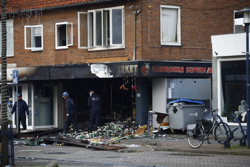 People inspect the debris after an explosion in Aalsmeer, near Amsterdam, Netherlands