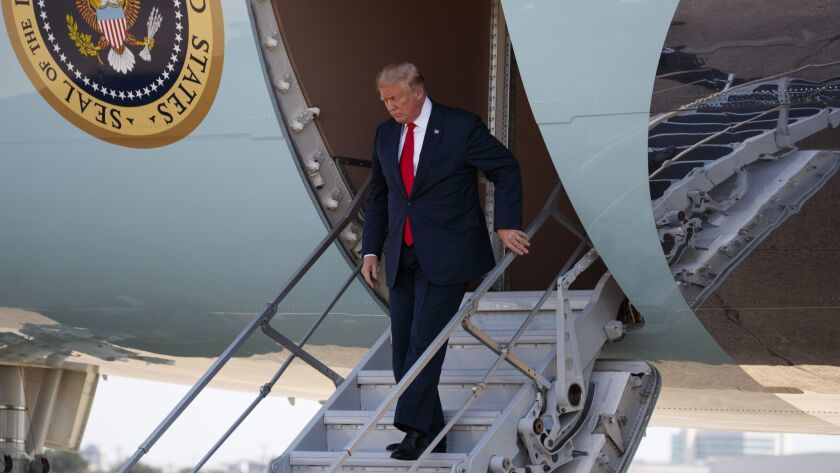 President Trump learned about Friday's jobs report numbers in a call from his top economic advisor while flying on Air Force One on Thursday.
