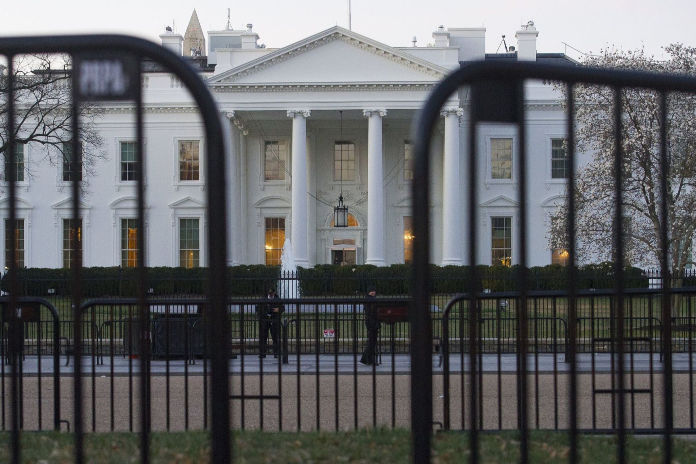 The White House behind security barriers.