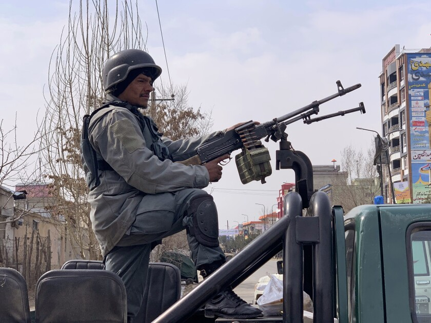 Afghan security personnel arrive at the site of an attack in Kabul, Afghanistan, on Friday.